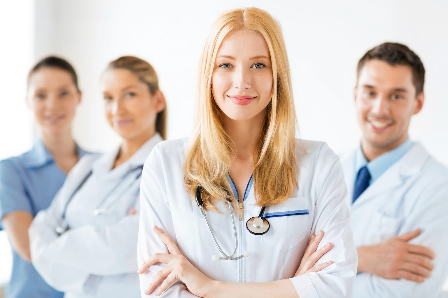 photodune-5079010-female-doctor-in-front-of-medical-group-m
